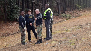 Wilson County Sheriff's Deputies investigate an area near Interstate 95 where armed robbers hijacked an armored truck, on Monday, March 2, 2015. (AP /The Wilson Times, Brad Coville)