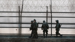 South Korean army soldiers patrol along a barbed-wire fence near the demilitarized zone between the two Koreas in Paju, South Korea on March 2, 2015. (AP / Ahn Young-joon)