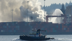 Smoke rises from a fire at the Port Metro Vancouver in Vancouver, British Columbia, on March 4, 2015. (AP / The Canadian Press, Jonathan Hayward)