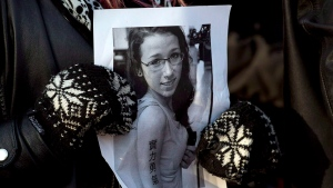 A woman holds a photo at a community vigil to remember Rehtaeh Parsons, at Victoria Park in Halifax, on Thursday, April 11, 2013. (Andrew Vaughan / The Canadian Press)