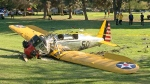 A small plane lies where it crash-landed on Penmar Golf Course in the Venice area of Los Angeles on Thursday, March 5, 2015. (AP / Damian Dovarganes)