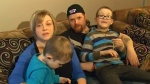 The Whalen family, with their son Landon sitting on his mother's lap, speak with NTV News.
