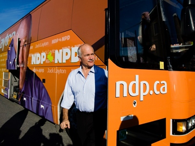 NDP Leader Jack Layton walks off his campaign bus to speak to supporters during a campaign stopi n Essex, Ont. on Sunday, Oct. 12, 2008. (THE CANADIAN PRESS / Nathan Denette)