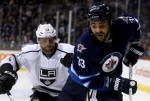 Los Angeles Kings' Marian Gaborik (12) lines up to hit Winnipeg Jets' Dustin Byfuglien (33) during first period NHL hockey action in Winnipeg on March 1, 2015. (Trevor Hagan / The Canadian Press)