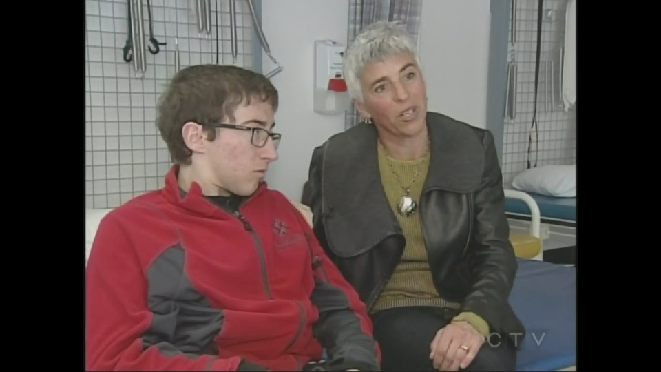Chris Madden, 21, who is living with spina bifida, and his mother Jacqueline discuss his care in London, Ont. on Friday, March 6, 2015. (Colleen MacDonald /CTV London)
