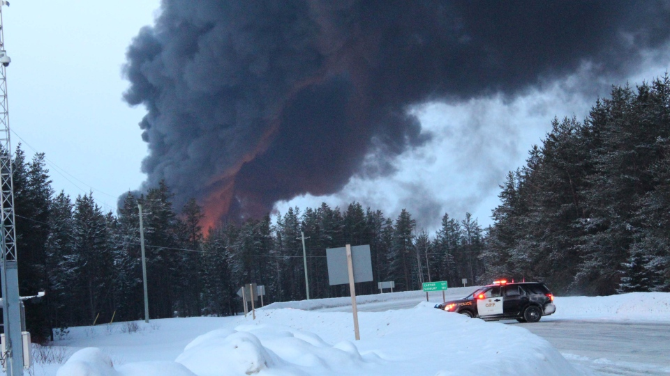 Burning fuel fills the sky with smoke after a train derailment near Gogama, Ont. on Saturday March 7, 2015. (Denise Brunet / MyNews)