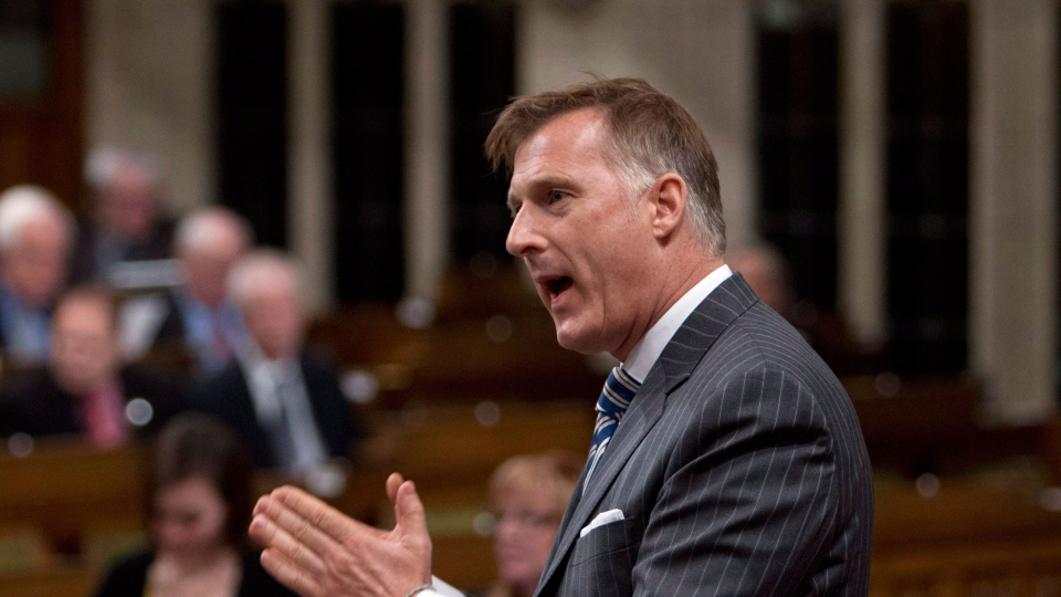 Maxime Bernier stands in the House of Commons during question period on Parliament Hill in Ottawa on Jan. 30, 2015. (Fred Chartrand / THE CANADIAN PRESS)