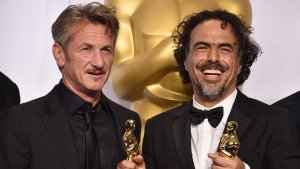 Sean Penn, left, and filmmaker Alejandro Iñárritu pose in the press room at the Academy Awards, on Feb. 22, 2015. (Jordan Strauss/Invision/AP)