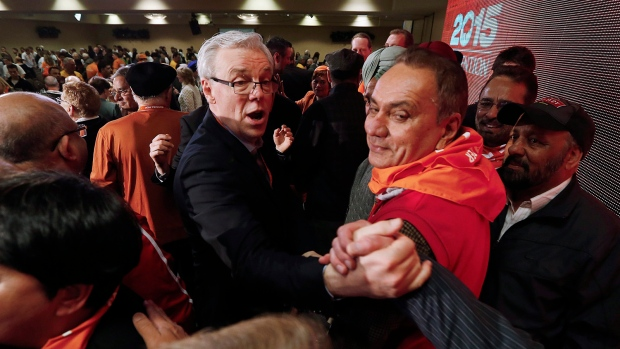 NDP Premier Greg Selinger celebrates hisnarrow win