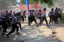 Myanmar police rush protesters