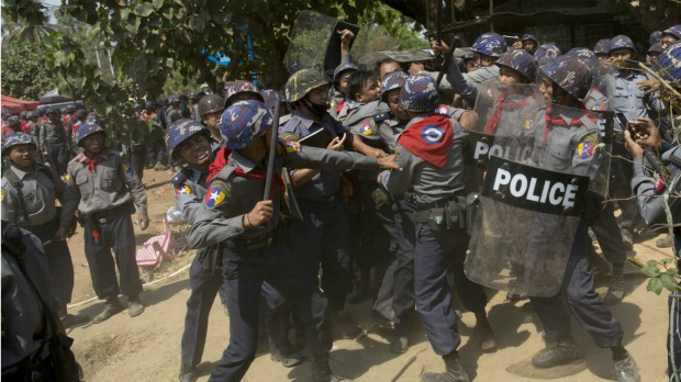 Myanmar police officers beat detain protesters