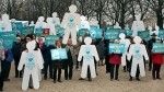 Demonstrators gather near the French National Assembly in silent protest against euthanasia, on March 10, 2015. (AP / Remy de la Mauviniere)