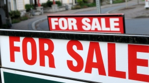 Real estate signs are seen in the greater Victoria municipality of Colwood, B.C., May 26, 2013. (Don Denton / THE CANADIAN PRESS)