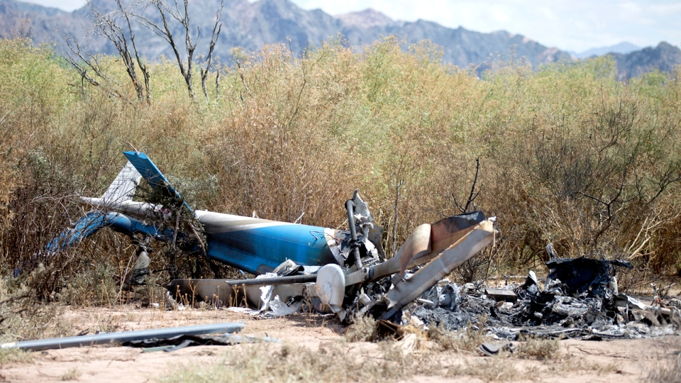 The remains of one of two helicopters that crashed sit on the ground near Villa Castelli, La Rioja province, Argentina, Tuesday, March 10, 2015. (AP / Natacha Pisarenko)