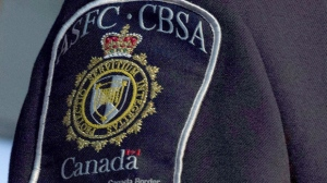 In this file photo, a Canada Border Service Agency shoulder patch is seen on Thursday, Sept. 12, 2013 in Ottawa. (The Canadian Press/Adrian Wyld)