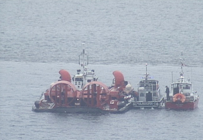 Search and rescue crews hunt for crew members who went missing from a ship that arrived in Vancouver Sunday. Oct. 13, 2008.