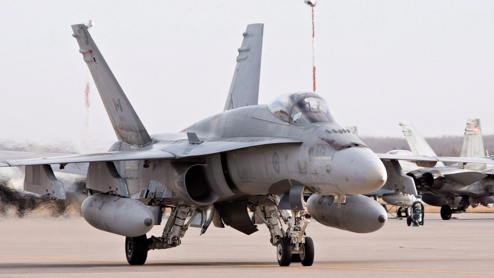 A pilot positions a CF-18 Hornet at CFB Cold Lake, in Cold Lake, Alta. on October 21, 2014. (Jason Franson / THE CANADIAN PRESS)