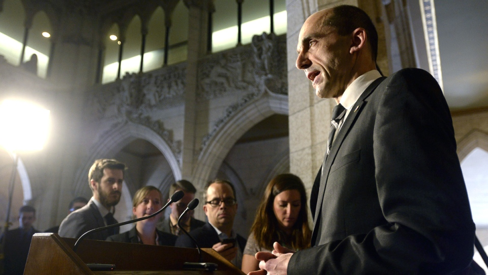 Public Safety Minister Steven Blaney comments on the arrest of a man plotting to blow up the U.S. consulate and buildings in Toronto's financial district, in the foyer outside the House of Commons in Ottawa, Wednesday, March 11, 2015. (Adrian Wyld / THE CANADIAN PRESS)
