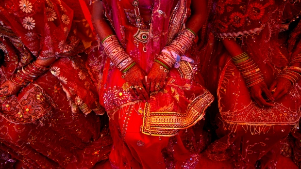 Indian brides dressed in wedding finery, wait for their grooms during a mass marriage ceremony in New Delhi, India, on Feb. 20, 2015. (AP / Saurabh Das)