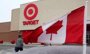 In this file photo, a Canadian flag flies on a customer's car parked in front of a Target store in in Guelph, Ont. on March 5, 2013. (Dave Chidley / THE CANADIAN PRESS)