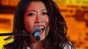 Chinese-Canadian star Wanting Qu performs on stage as W5 followed her during a 25-city tour in China.