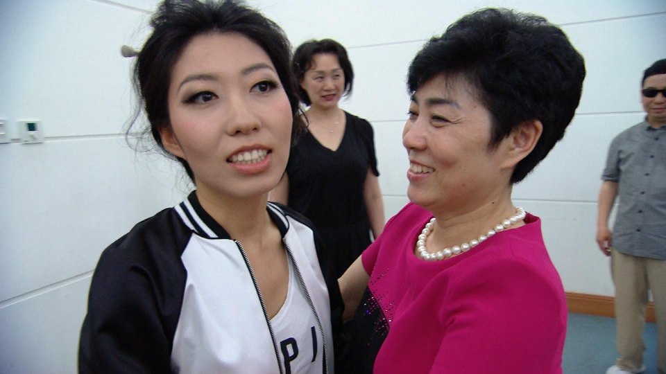 Qu Zhang Mingji, right, with her daughter, pop singer Wanting Qu.