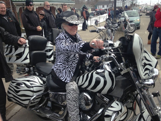 Wanda Patrick sits atop her zebra-striped motorcycle at a Friday the 13th celebration in Port Dover, Ont., on Friday, March 13, 2015. (Krista Simpson / CTV Kitchener)