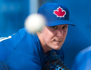 Toronto Blue Jays pitcher Aaron Sanchez pitches in the bullpen during baseball spring training in Dunedin, Fla., on Tuesday, February 24, 2015. (Nathan Denette/THE CANADIAN PRESS)