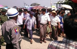This image provided by DVB shows officials arriving near Kyauk Phyu port, Myanmar in response to a ferry capsizing on March 14, 2015. (AP / DVB)