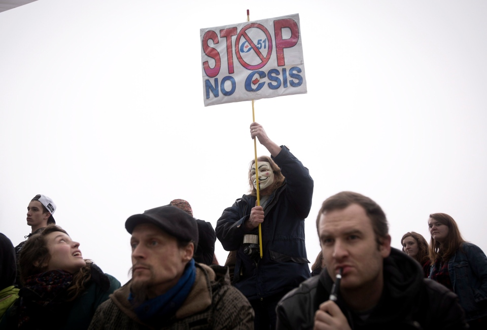 A demonstrator holds up a sign while protesting on a national day of action against Bill C-51, the government's proposed anti-terrorism legislation, in Toronto on Saturday, March 14, 2015. (Darren Calabrese / THE CANADIAN PRESS)