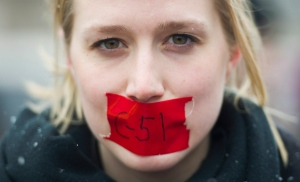 A woman protests on a national day of action against Bill C-51 in Montreal on March 14, 2015. (Graham Hughes / The Canadian Press)