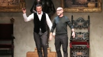 Italian fashion designers Domenico Dolce, right, and Stefano Gabbana acknowledge the applause of the audience after a men's Autumn-Winter 2014 collection, part of the Milan Fashion Week, unveiled in Milan, Italy in this Jan. 11, 2014 file photo. (AP / Antonio Calanni)