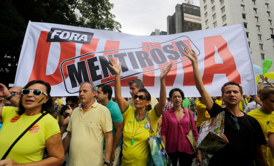 "Demonstrators hold up a banner that reads in Portuguese ""Dilma liar"" as they march to demand the impeachment of Brazil's President Dilma Rousseff in Sao Paulo, Brazil on March 15, 2015. (Nelson Antoine / AP Photo)"