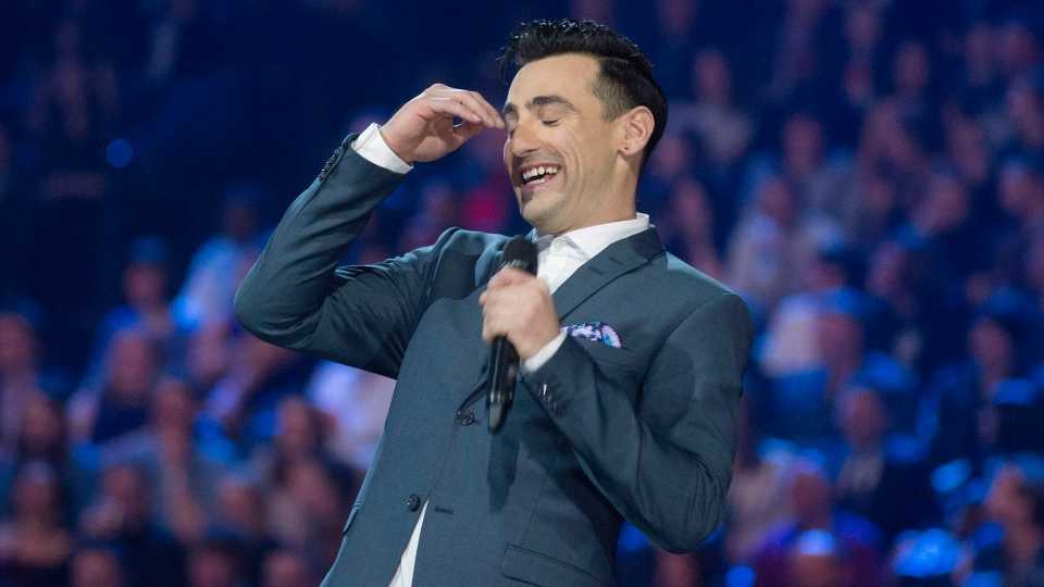 Jacob Hoggard of the band Hedley laughs while hosting the 2015 Juno Awards in Hamilton, Ont., on Sunday, March 15, 2015. (Nathan Denette / THE CANADIAN PRESS)
