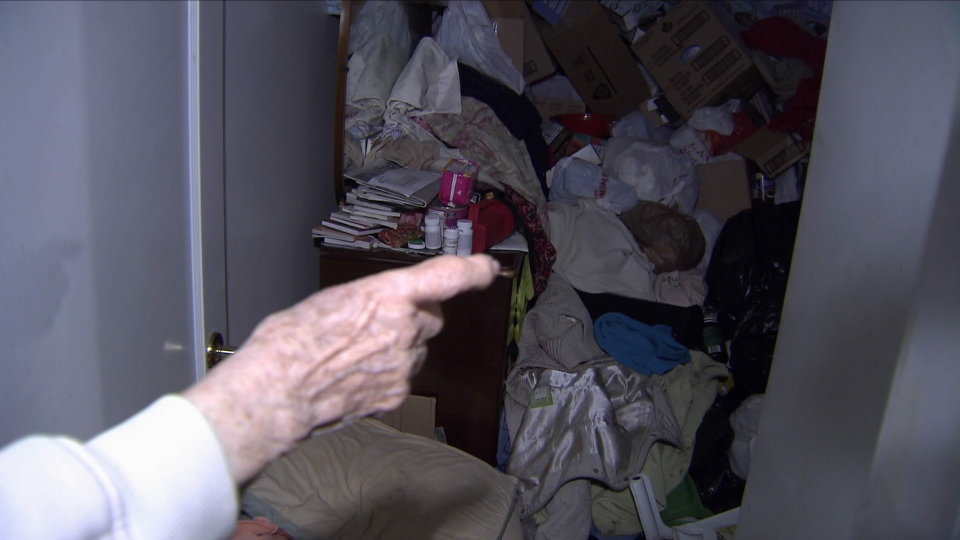 Pauline Jollymour, 92, has set up several pillows to make a makeshift bed in her bedroom, which is buried by clutter. March 15, 2015. (CTV)