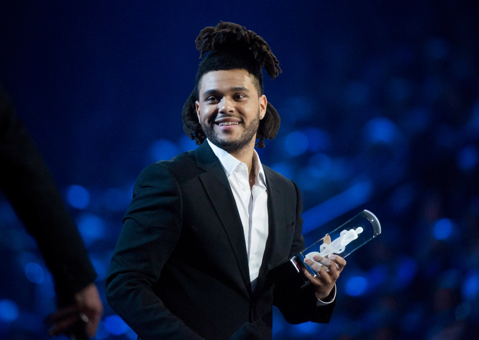 The Weeknd receives the Juno for Artist of the Year during the 2015 Juno Awards in Hamilton, Ont., on Sunday, March 15, 2015. (Nathan Denette / THE CANADIAN PRESS)