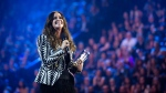 Alanis Morissette receives her achievement from the Canadian Music Hall of Fame during the 2015 Juno Awards in Hamilton, Ont., on Sunday, March 15, 2015. (Nathan Denette / THE CANADIAN PRESS)