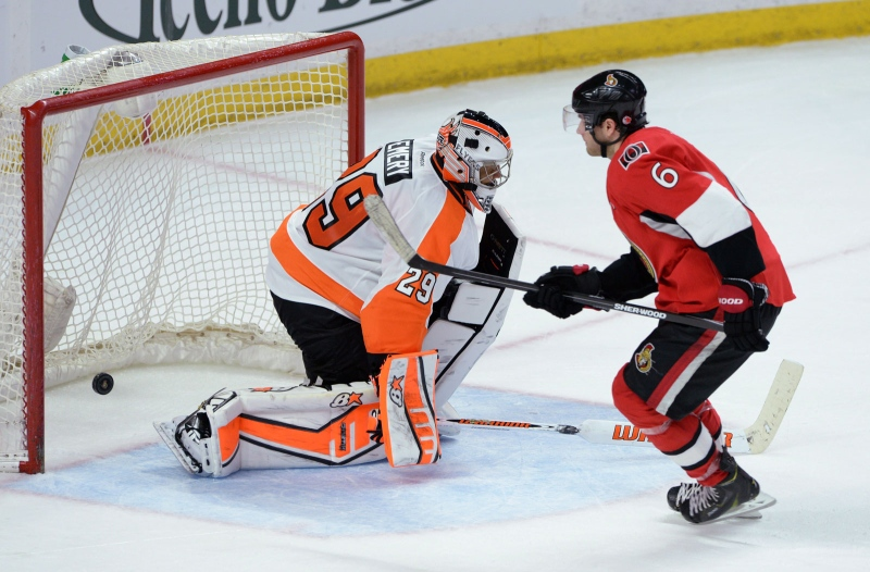 Ottawa Senators' Bobby Ryan puts the game winning shot past Philadelphia Flyers' Ray Emery during shoot-out NHL hockey action in Ottawa on Sunday, March 15, 2015. THE CANADIAN PRESS/Sean Kilpatrick