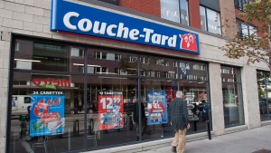A man passes by a Couche Tard convenience store in Montreal, on October 5, 2012. (Graham Hughes/The Canadian Press)