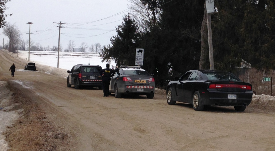 Wellington County OPP investigate after a person was found dead in a vehicle near Belwood, Ont., on Monday, March 16, 2015. (Brian Dunseith / CTV Kitchener)