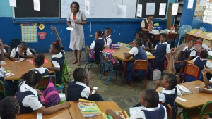 FILE PHOTO - Allison Clarke leads a grade three class at Jamaican primary school in Kingston, Jamaica, on In this Feb. 2, 2015. (AP Photo/David McFadden)