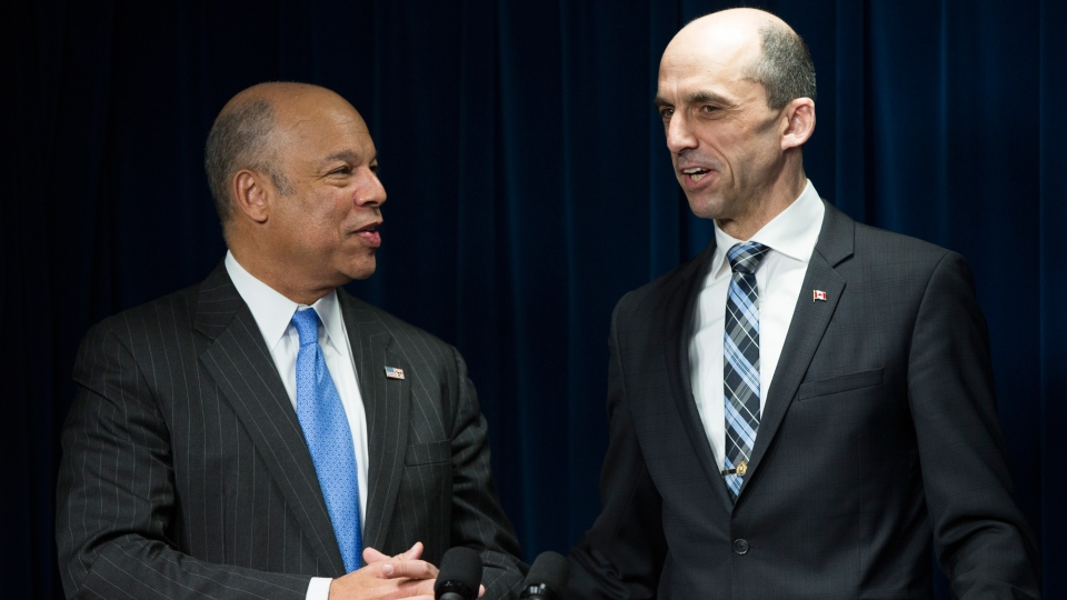 Homeland Security Secretary Jeh Johnson, left, and Canadian Minister of Public Safety and Emergency Preparedness Steven Blaney answers questions in Washington, Monday, March 16, 2015, during a ceremony to sign a preclearance agreement as part of the Beyond the Border Initiative. (AP / Evan Vucci)