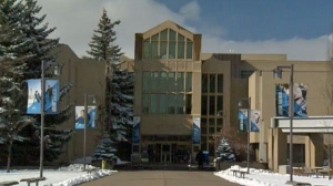 Eighteen members of the Mount Royal University Cougars men's hockey team, including coaching staff have tested positive for COVID-19.