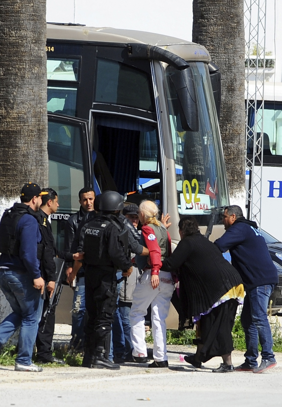 Tourists and visitors being evacuated from the Bardo museum after gunmen opened fire at the leading museum in Tunisia's capital on Wednesday, March 18, 2015.  (AP / Hassene Dridi)