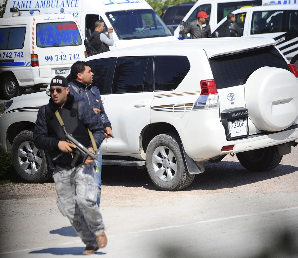 A member of security forces runs outside the Bardo museum after gunmen opened fire at the leading museum in Tunisia's capital on Wednesday, March 18, 2015. (AP / Hassene Dridi)