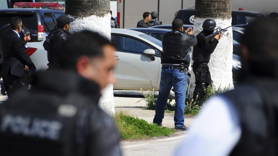 Security officers man positions outside the Bardo Museum after an attack on the museum by gunmen in Tunis, Tunisia, Wednesday, March 18, 2015. (AP / Salah Ben Mahmoud)