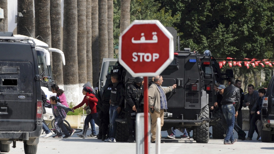 Rescue workers evacuate children, left, and adults after gunmen opened fire at the Bardo museum in Tunisia's capital, in Tunis, Tunisia, Wednesday, March 18, 2015. (AP / Ali Ben Salah)