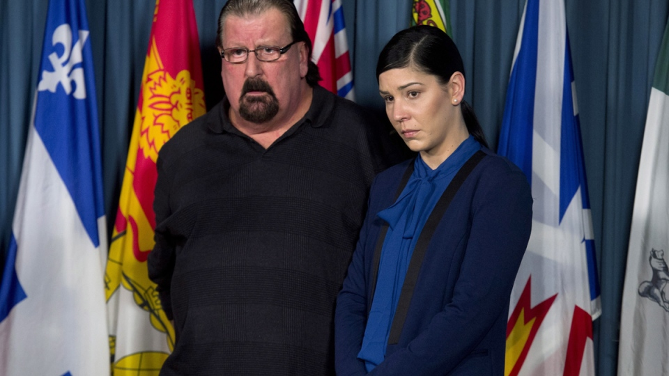 Chris Huck stands with his daughter Stephanie Huck after she talked about her son Daniel Ten Oever during a news conference in Ottawa, Wednesday, March 18, 2015. (Adrian Wyld / THE CANADIAN PRESS)
