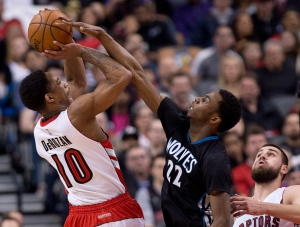 Toronto Raptors' DeMar DeRozan (10) gets fouled by Minnesota Timberwolves' Andrew Wiggins (22) during first half NBA basketball action in Toronto on Wednesday, March 18, 2015. (Nathan Denette / THE CANADIAN PRESS)