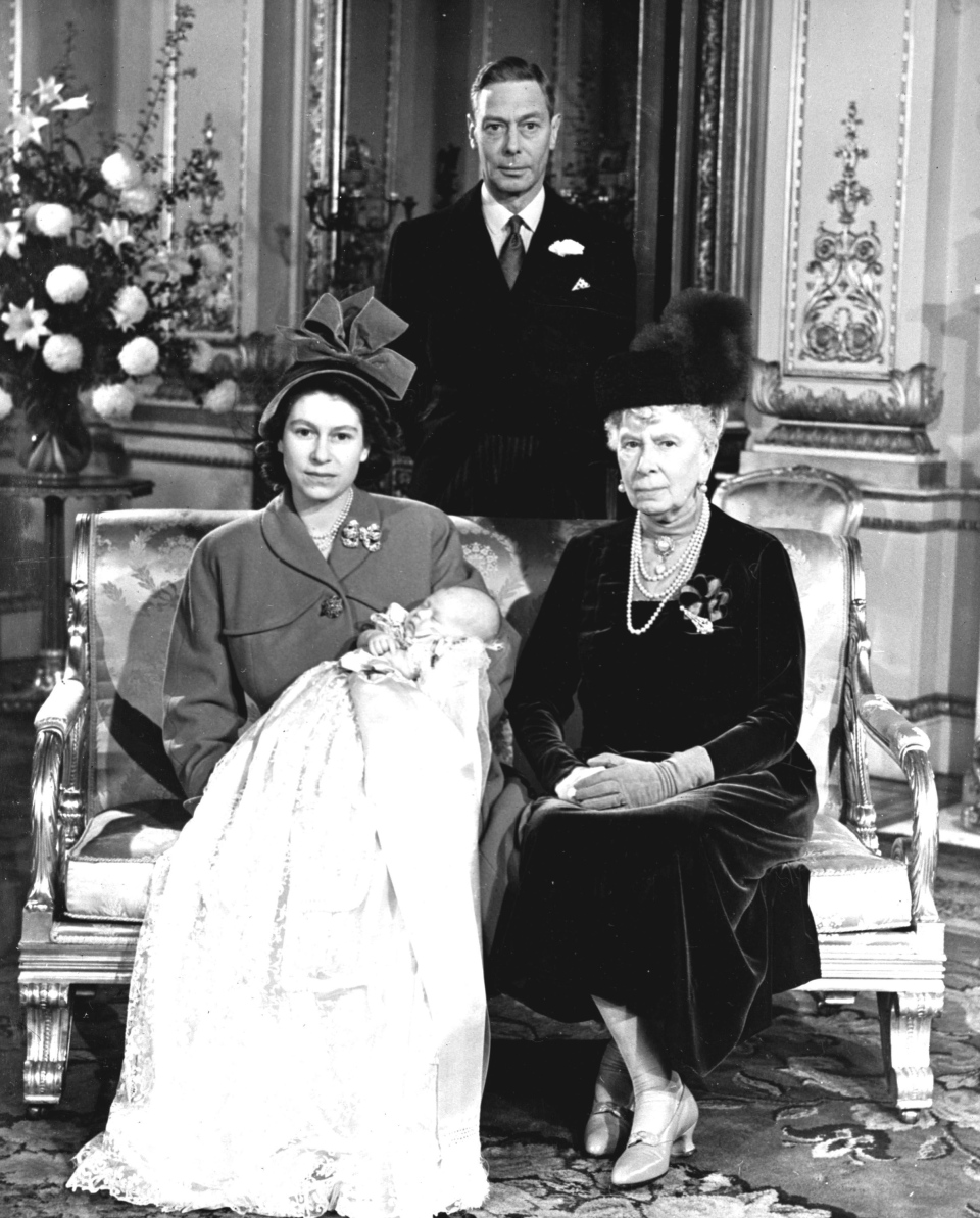 Princess Elizabeth, later Queen Elizabeth II, holds her son Prince Charles at Buckingham Palace, following his christening, Dec. 15, 1948. (AP Photo)